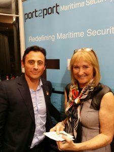 First Thursday Sponsor Port2Port Chris Farrel hands raffle prize to Debbie Simpkins of InExpress