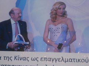 Nicky Papadakis on the left holding his award