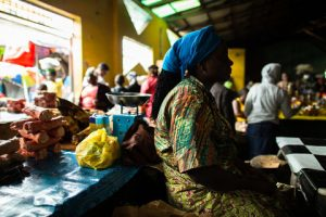 With the cost of transport and goods going up and sales going down since the Ebola outbreak, vendors in Waterside Market, Monrovia, Liberia, are making no profit to support their families. Photo: UNDP/Morgana Wingard