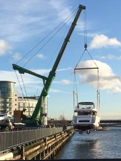 Sunseeker yacht lifted at CWM FX London Boat Show 2015