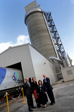 ABP Director Humber, John Fitzgerald, Dorothy Thompson CBE, Chief Executive, Drax; Cllr Mary Glew, Lord Mayor of Hull and Admiral of the Humber and ABP Chief Executive James Cooper in front of the Port of Hull's dedicated biomass terminal (image courtesy of ABP / David Lee Photography