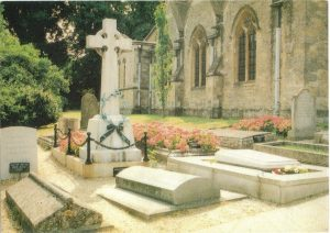 St Martin's, Bladon, cemetery.  The Celtic cross marks Lord Randolph Churchill's grave; that of Winston and Clementine is at the front right with flowers.