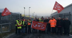 Mick Ward (left of banner) and other protesters at Motherwell City Link Depo