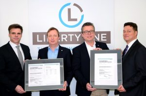 Matthias Ritters, Regional Manager Germany at DNV GL (left), and Frank Hensel, Key Account Manager at the classification society (right), hand over the ISO certificates to Liberty One's Managing Director Dietrich Schulz (second from right) and Capt. Jan Stahmer, responsible for HSEQ (Photo: DNV GL)