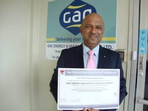 Gobind Kukreja, Managing Director of GAC Energy and Marine Services in Trinidad & Tobago presents the STOW (Safe TO Work) certification.
