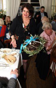 Martha-Maria Chrysomallis presenting the evening's GPA cake and Geoffrey Robertson QC