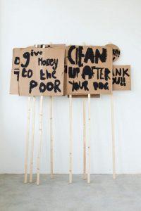 Image 1 - Peter Liversidge, Placards, Notes on Protesting 2014, Black Emulsion, Cardboard & wood