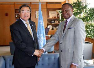IMO Secretary-General Koji Sekimizu welcomes His Excellency Paul William Lumbi, Zambia's High Commissioner to the United Kingdom.