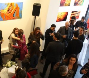 Joyful greetings at private view evening.