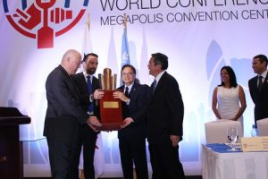 MSC Peter Blohm receiving the Maritime Excellence Award from the Minister of the Canal and SG IMO and Ricardo Esquilsen MSC Legal Representative in Panama