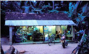 Village shop at dusk in Sri Lanka lit by solar panels. Photo: World Bank/Dominic Sansoni