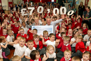 Children from Marfleet Primary School celebrate with Acting Head Teacher Antonia Saunders and ABP Director Humber, John Fitzgerald celebrate ABP's fundraising total (image courtesy of ABP/David Lee Photography