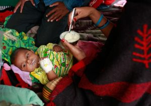 A woman feeds her infant, who was injured during the massive 25 April earthquake, at Tribhuvan University Teaching Hospital in Kathmandu, the capital of Nepal. Photo: UNICEF/NYHQ2015-1014/Nybo