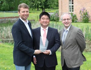 Dr Tatsuo Nishikawa (middle) is presented with the DNV GL Compit Award 2015 by Albrecht Grell (left), Director of the Maritime Advisory Division at DNV GL - Maritime, and COMPIT organiser Volker Bertram (right), DNV GL - Maritime.