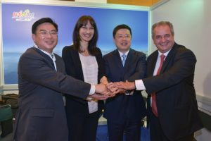 Greek Alternate Ministress of Tourism Elena Kountoura with official from China and Greece