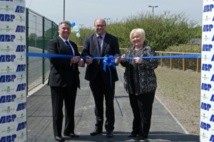 ABP Head of Projects Simon Brett (centre) helps Jim Tulloch, Chairman of the Hull & Holderness Ramblers Association and Deputy Lord Mayor of Hull Anita Harrison cut the ribbon to open the new footpath and cycleway (image courtesy of ABP/David Lee Photography)