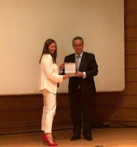 Danae Bezantakos receiving her award from Costas Michalos