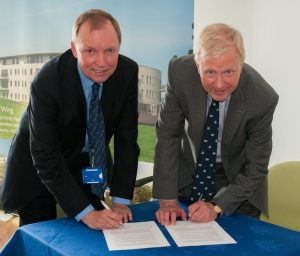 Vice Admiral Peter Wilkinson (right), Chairman of Seafarers UK, and Mike Jess, Secretary of the Nautilus Welfare Fund, sign the Memorandum of Understanding for the new Seafarers UK Centenary Wing at the Trinity House Hub retirement complex on Mariners' Park.