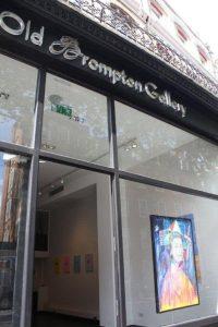 Old Brompton Gallery frontage featuring artist Woozy's portrait Elizabeth.