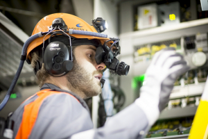 Wärtsilä's service engineer utilising advanced augmented reality technology on board of a vessel.