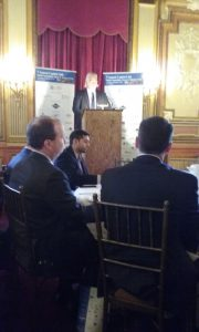 Peter Georgiopoulos at the podium