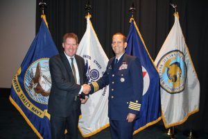 Mr Kingston receives an award from Capt Mauger of the US Coast Guard forpromoting maritime safety. Photo: US Coast Guard