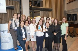 The WISTA Hellas President, Angie Hartmann, and members participating in the AGM with theAward