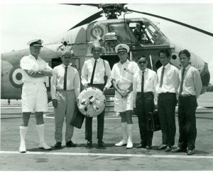 Capt Place, commanding officer of HMS Albion, welcomes visitors from Borneo, 1966. Copyright Paul Watkins.