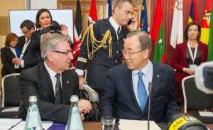 Secretary-General Ban Ki-moon (right) confers with Karmenu Vella, European Commissioner for the Environment, Maritime Affairs and Fisheries at a special session on climate change as the Commonwealth Heads of State and Government meet in Malta. UN Photo/Rick Bajornas