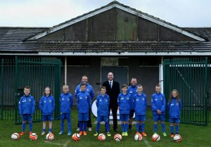 Mike Sellers, ABP Port Manager Grimsby and Immingham (centre) with under 10s coaches Mark Davis and Andrew Dunks with their Immingham Pilgrims AFC team.(image courtesy of David Lee Photography/ ABP