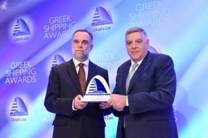 Prof. Stefanos Gritzalis, Rector of the University of Athens accepting the Award on Achievement on Education or Training from Antonis Comninos  of Target Marine Group