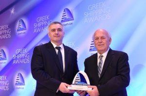 "Mihail Georgiev, Vetting Superintendent of RightShip presenting the trophy to Captain Vangelis Kouzilos, president of the Liberty Organisation on behalf of ""Hellas Liberty"""