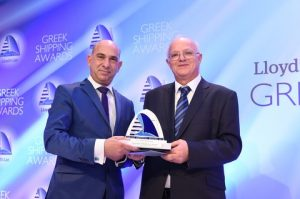 Andreas Chrysostomou receiving the International Personality of the Year Award from Evangelos Mverolos of Capital Ship Management Copr.