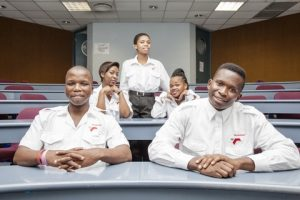 Below Left: General Purpose Rating (GPR) students Sabelo Buthelezi, Aphiwe Luthuli, Tracy Hlophe, Nomcebo Nkwanyana and Themba Kumalo are all smiles at the end of the first stage of their GPR maritime training at the School of Maritime Excellence – a four week bridging course in Mathematics
