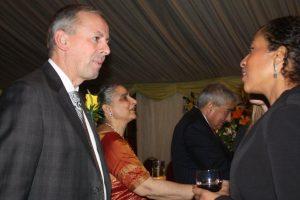 Richard Sadler (left), Mrs Manju Mehrotra (centre) and Ravi Mehrotra greetguests.