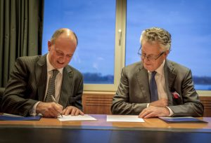 Sir Michael Bibby of Bibby Line Group and Kommer Damen of Damen Shipyards sign contract for Bibby WaveMaster 1