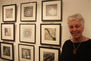 Buffy Kimm with a selection of her etchings.