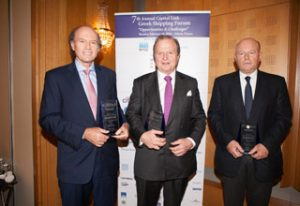 The Tsavliris borthers; Andreas, George and Nicolas holding their Leadership Awards