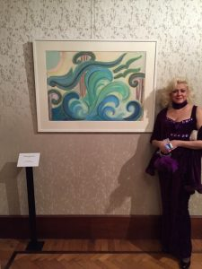 Dimitra Moutzouris and one of her paintings