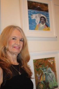 Linda Sutton with her paintings Il Matto and The Fairy Queen
