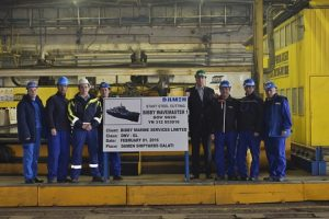René Hooijman (Senior Project Manager, Damen Shipyards Group) and personnel of Damen Shipyards Galati at the steel cutting ceremony of the Bibby WaveMaster 1.