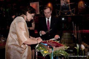 Martha Chryssomalis with the Greek Ambassador Constantinos Bikas cutting the cake - picture by Katerina Kalogeraki