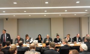 The moderator Sir Bernard Eder introducing pannelists of session 2