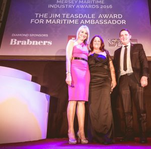 Angie Redhead, winner of the Jim Teasdale Award for Maritime Ambassador 2016 (centre)pictured with event host Louise Minchin (left) and Andrew Hart (right) on behalf of award sponsor Liverpool Football Club.