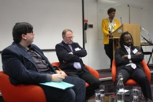 During panel discussion. From left Fotios Katsoulas, Richard Clayton and Ikenna Iroche. Gemina Dina in background.