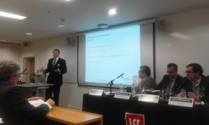Dr. Platon Monokroussos presenting the book; on hte right the panel with Prof. Kevin Feartherstone
