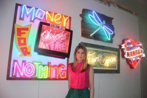 Alexa Pearson with Lights of Soho display.