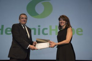 Irene Charalampopoulou accepting the donation from George D. Pateras, president of the HCS