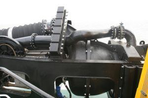 The semi axial dredge pump is frame mounted and parts of the trailing pipe