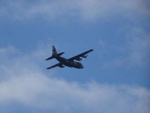 A SAR plane flying over the area of the accident